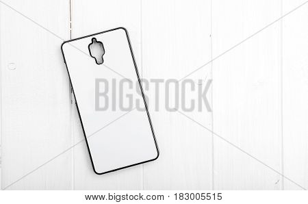 white phone case for prnting lying on white table