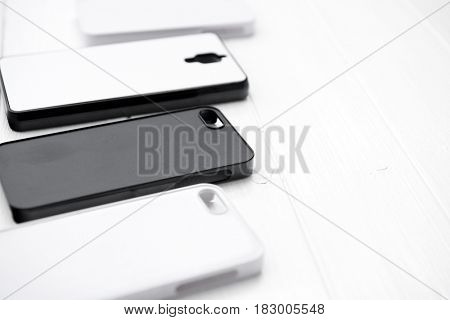 Raw of black and white cases for printing made of nice material, lying on the table