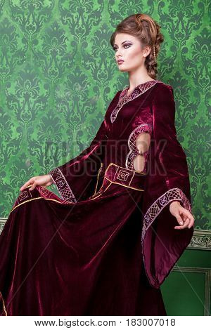Vogue woman dressed in vintage clothes in retro interior. Rococo period. Luxury and high class