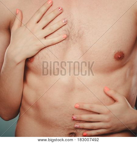 Sexy passionate couple lovers in studio. Woman hands embracing naked nude man. Love and passion.