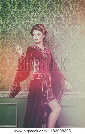 Romantic woman dressed in vintage clothes in retro interior. Rococo period. Luxury and high class