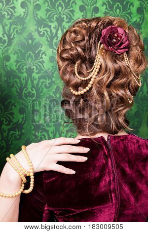 Hairstyle in vintage style on retro pattern background. Rococo period. Luxury and high class