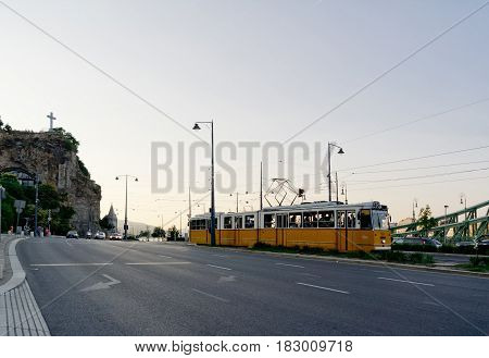 BUDAPEST HUNGARY - JUNE 17: Old yellow tram in Budapest capital city in Hungary near Danube river. The image was taken on June 17 2013.