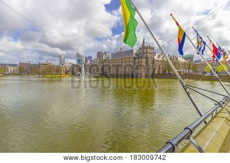 Parliament buildings of the Binnenhof and Hofvijver pond in front of the skyline of The Hague The Netherlands.