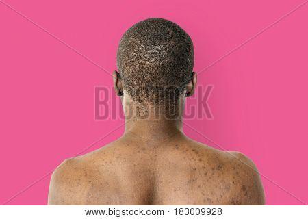 Man shirtless rear view studio portrait