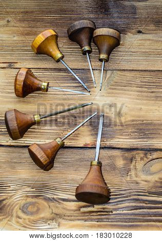 Different Gravers For Jewelry On Wooden Background