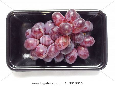 grapes on black tray with white background