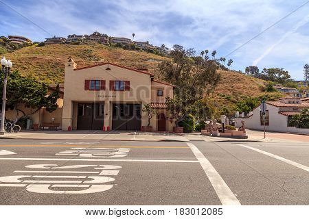 Laguna Beach California April 22 2017: Laguna Beach fire station one next to town hall with the hillside homes behind it in the center of town. Editorial use only.