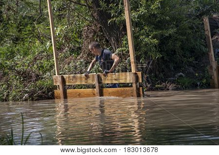 A Man Is Crossing Alone A River
