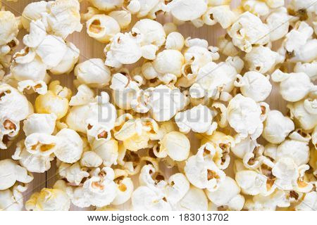 Salted Popcorn On A White Table. Top View.