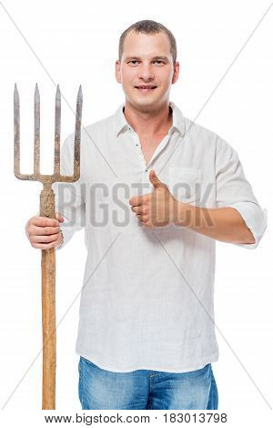 Successful Gardener With A Pitchfork On A White Background Posing