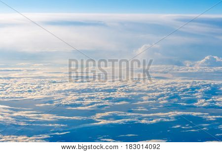 The colorful sky above the clouds - airplane traveling in the summer