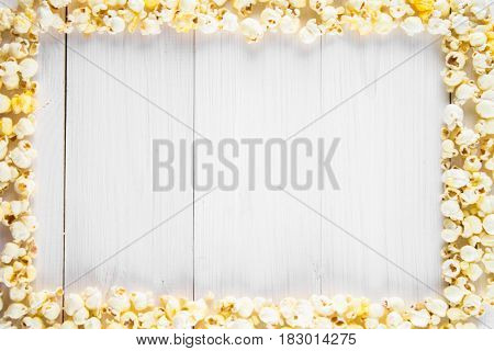 Salted Popcorn In The Form Of A Frame On A White Table. Top View. Empty Space For Text.