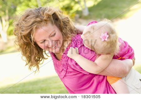 Mother and Daughter Piggyback Ride in the Park.