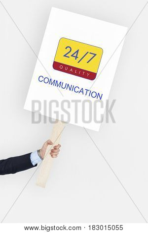 Hand holding a banner with 24/7 service
