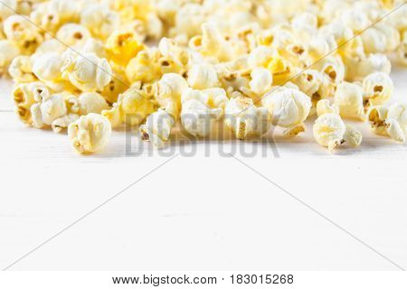 Salted Popcorn On A White Table. Top View. Empty Space For Text.