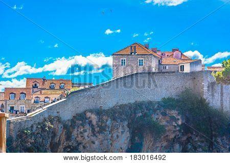 Picturesque view at city walls in town Dubrovnik, popular touristic destination on Adriatic Coast, Croatia.
