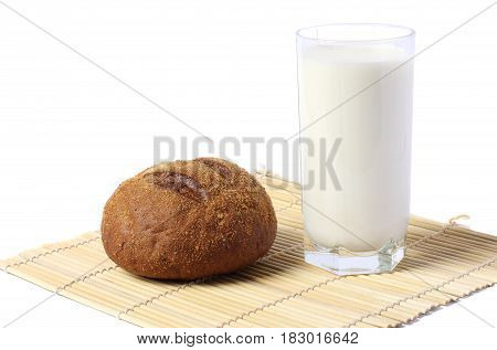 Glass of fresh milk with biscuit isolated on white background