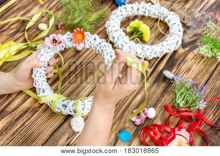 Child making handmade decorations for holliday .