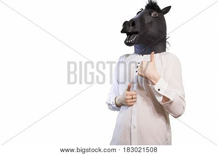 Businessman In A Horse Mask Shows Thumb Up Isolated On White Background