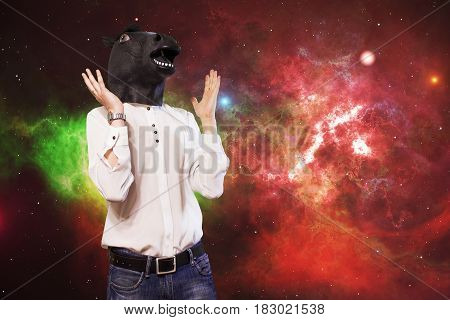 Businessman In A Horse Mask Is Indignant Over The Background Of Space