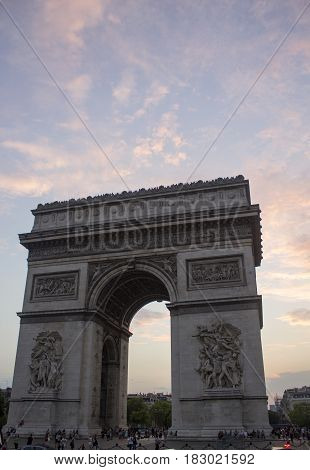 Sun setting at the Arc de Triomphe