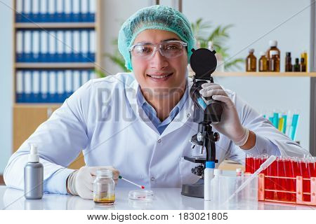 Young doctor working on blood test in lab hospital