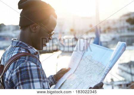 Youth And Travel Concept. Half-profile Portrait Of Dark-skinned Hipster-looking Tourist Just Arrived