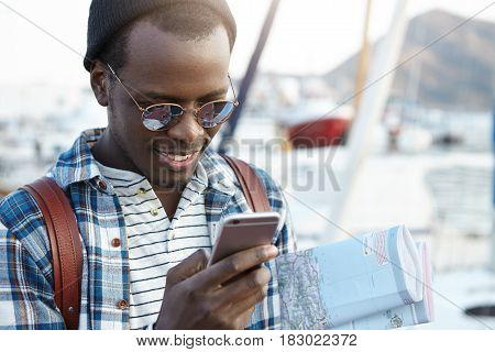 Happy And Cheerful African American Man Traveling In European Resort Town Alone With Paper Map, Look