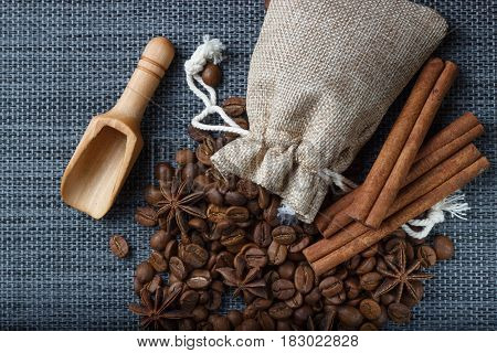 Bag of coffee beans with anise on sackcloth