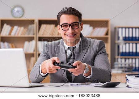 Businessman playing computer games at work office