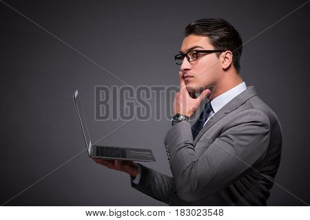 Handsome businessman working on laptop computer