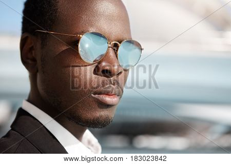 Close Up Highly-detailed Shot Of Handsome Serious Afro American Office Worker In Formal Wear And Mir