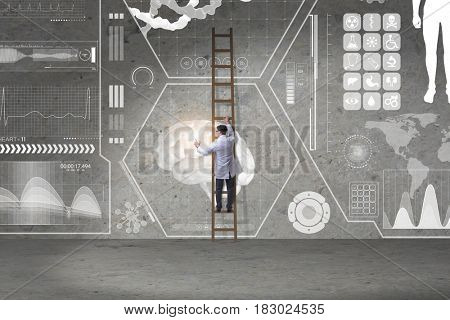 Male doctor climbing ladder in medical concept