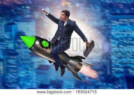 Male businessman flying on rocket in business concept