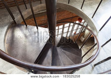 Close up of a modern steel spiral staircase.