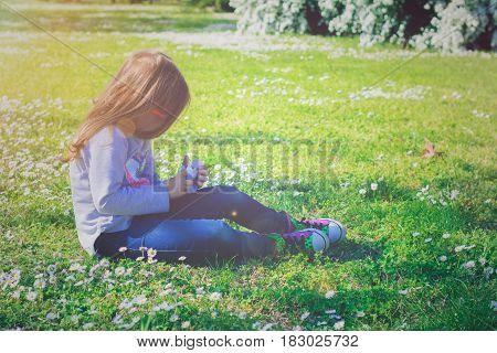 Little girl enjoys day in the park