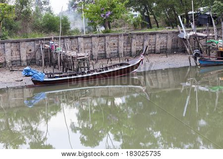 Long tail boat or fishing boat in the canal at phuket thailand