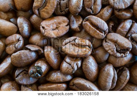 Coffee beans closeup - background. Shallow depth of field.