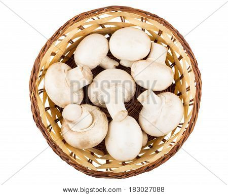 Wicker Basket With Raw Mushrooms Isolated On White