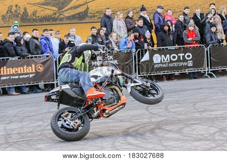St. Petersburg Russia - 15 April, Biker in front of spectators on the rear wheel,15 April, 2017. International Motor Show IMIS-2017 in Expoforurum. Sports motorcycle show of bikers on the open area.