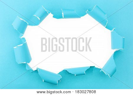 Ripped blue paper on white background with space for text