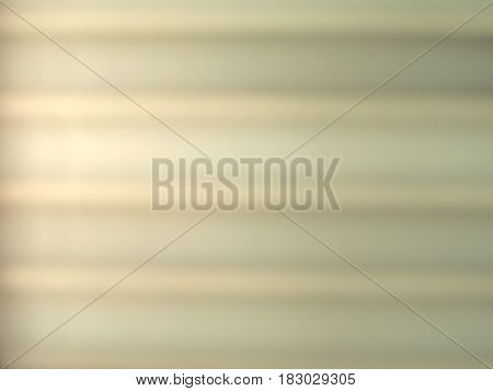 blurred shadow of window blinds on a wall useful as a background