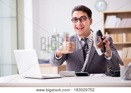 Helpdesk operator talking on phone in office