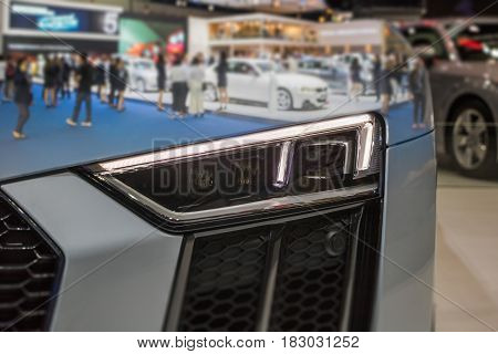 Double exposure Closeup Front Headlight car in Motor Show