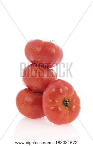 Big red fresh French tomatoes type Coeur de boeuf isolated over white background