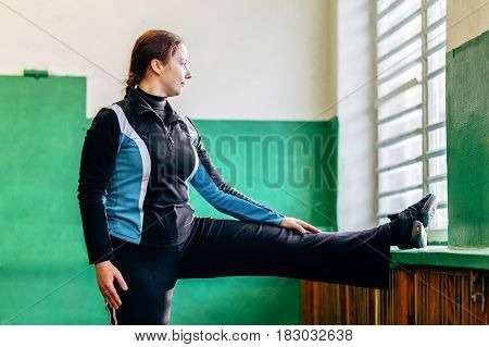 Young attractive girl doing exercises in the gym, Stretching the legs