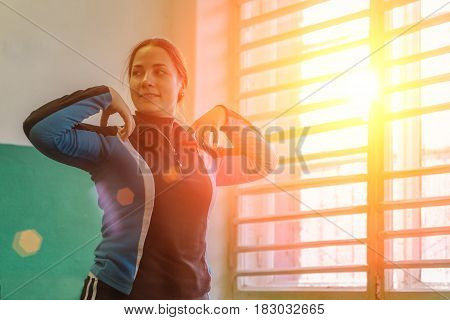 Young attractive woman doing exercises, training in the gym. Fitness, workout, healthy diet concept