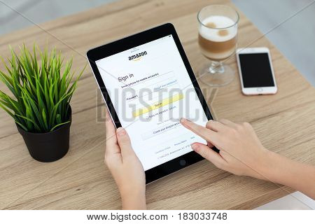 Alushta Russia - September 15 2016: Woman holding a iPad Pro with Online shopping service Amazon on the screen. iPad Pro 9.7 Space Gray was created and developed by the Apple inc.