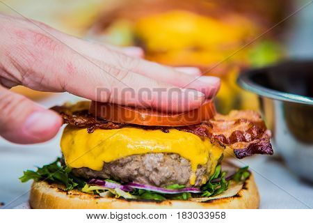 A burger waiting to be finished on the table